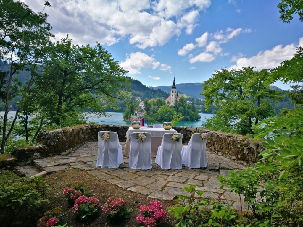 Table at Vila Bled wedding reception with view on the Bled Island