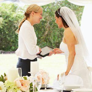 Wedding planner going through details with bride